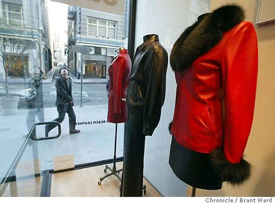 leather_002_bw.jpg North Beach Leather is liquidating all its stores except the one on Grant Avenue in San Francisco, shown here. The company has been around for 35 years. A passerby looked up as he passed the Grant Ave. store. BRANT WARD / The Chronicle Photo: BRANT WARD