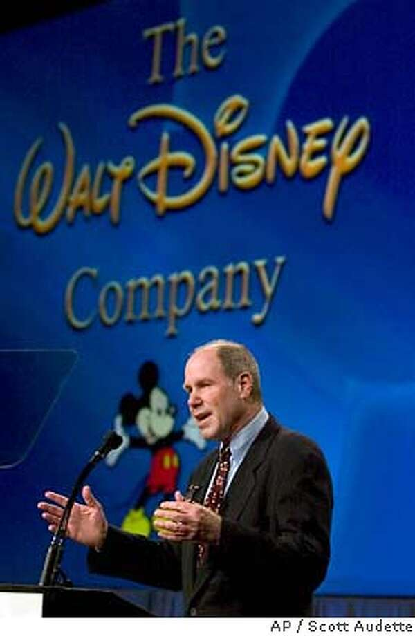 Michael Eisner, CEO and Chairman of The Walt Disney World Company gestures as he delivers the earnings report for the quarter ended December, 31, 2003 with investors and analysts on Wednesday, Feb. 11, 2004 at the Walt Disney World Investors Conference 2004 at the Walt Disney World Resort in Lake Buena Vista, Fla. (AP Photo/Scott Audette) Photo: Scott Audette