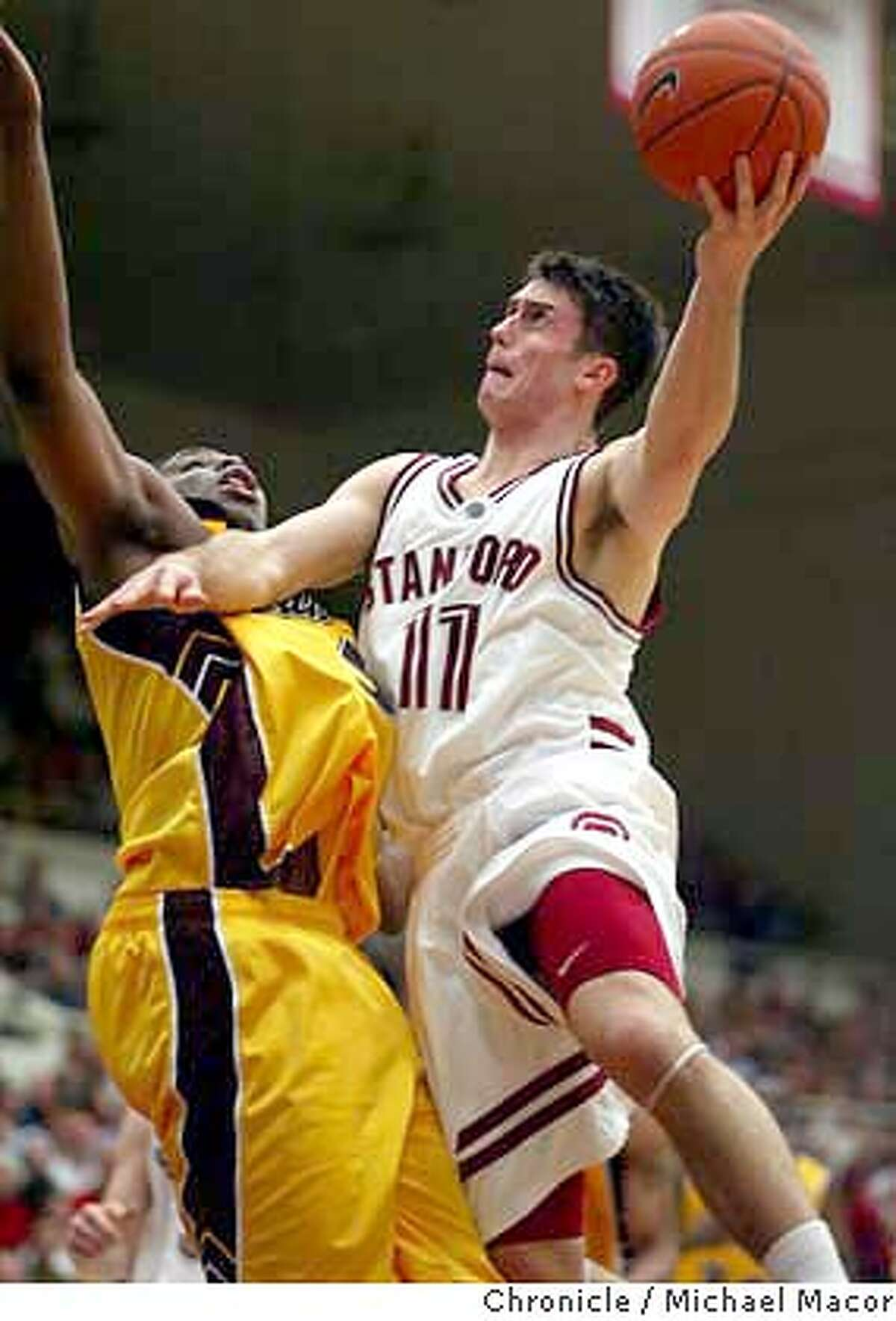 Stanford's 11- Chris Hernandez up and over Arizona's 5-Ike Diogu for two in the first half. Mens College Basketball Stanford Cardinal vs. Arizona Sun Devils. event on 2/5/04 in Palo Alto Michael Macor / The Chronicle