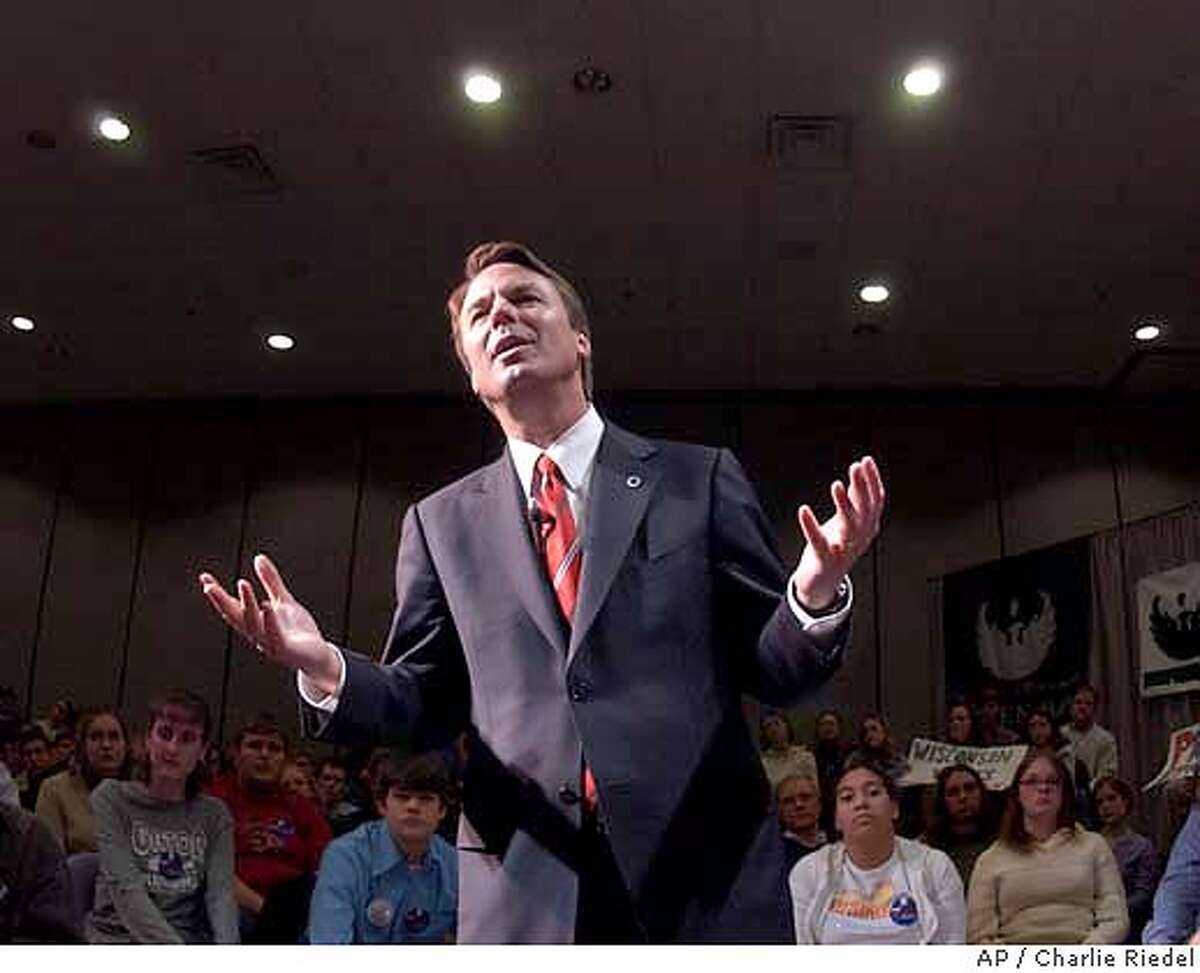 Democratic presidential hopeful U.S. Sen. John Edwards answers questions during a rally at the University of Wisconson at Green Bay in Green Bay, Wis. Wednesday, Feb. 11, 2004. (AP Photo/Charlie Riedel)