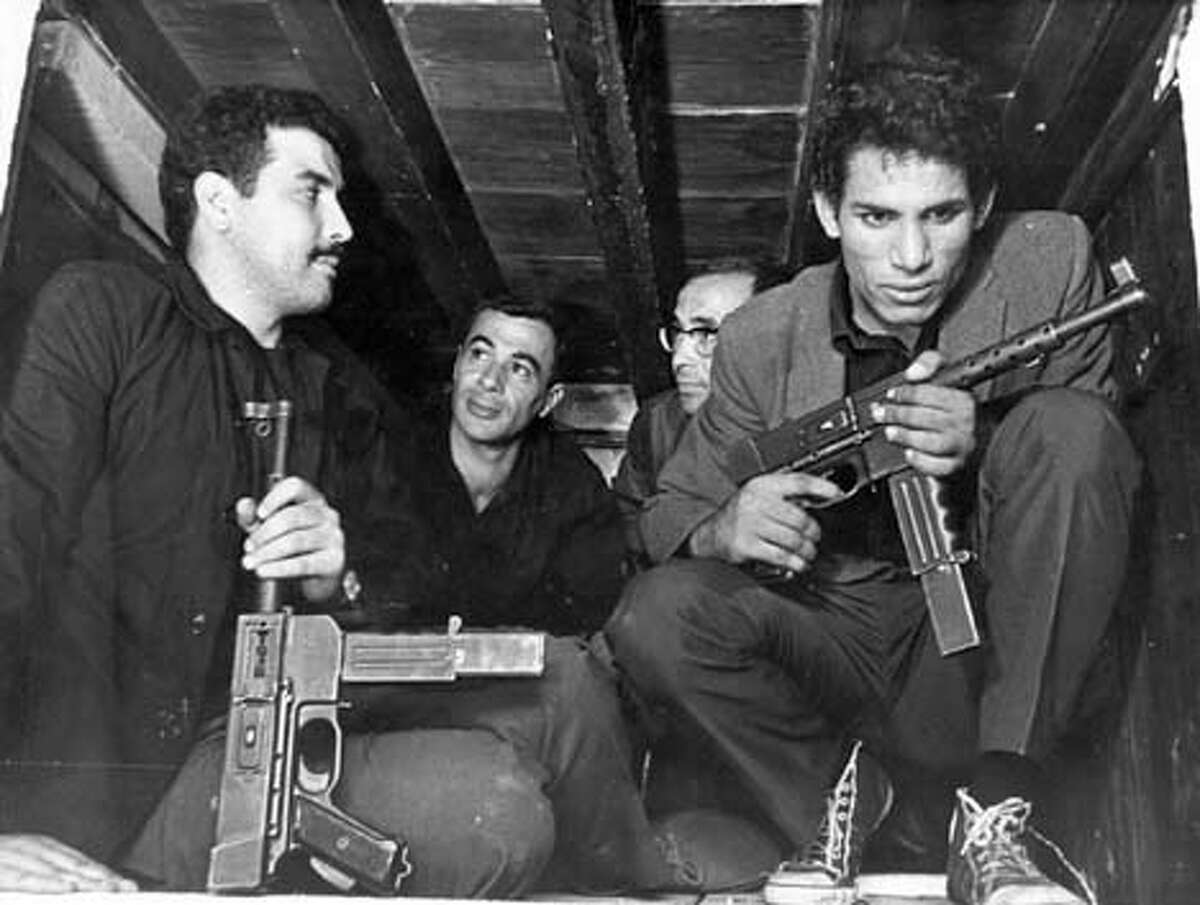 ALGIERS12 Saadi Yacef, as revolutionary leader El-hadi Jaffar (second from the left) and Brahim Haggiag (right) as revolutionary leader Ali La Pointe in a scene from Gillo Pontecrvo's The Battle of Algiers (1965). Saadi Yacef (second from left) and Brahim Haggiag (right) play revolutionary leaders in The Battle of Algiers, starting a two-week run at the Castro Theatre on Friday.