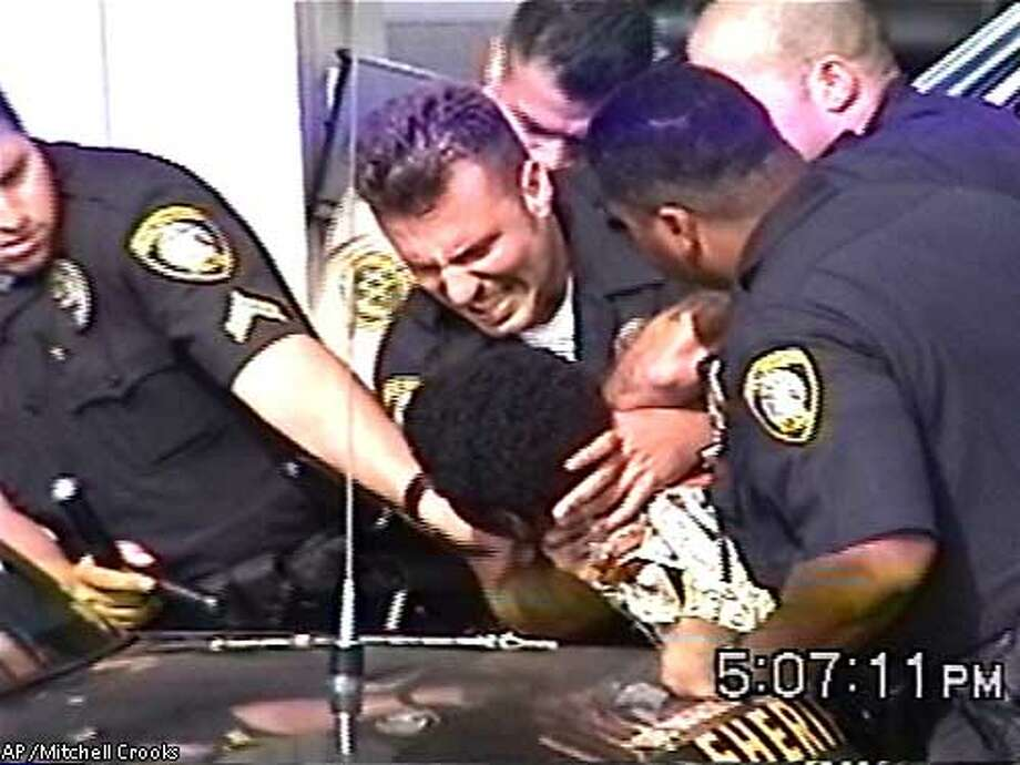 Officer suspended over arrest video / Teen shown getting slammed
