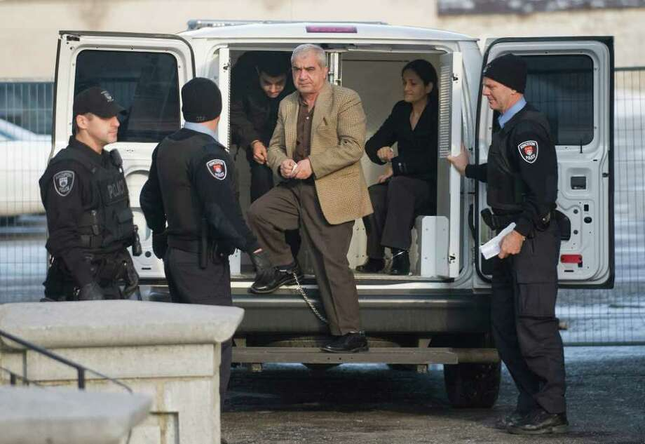 Mohammad Shafia (center) Tooba Yahya (right) and Hamed Shafia (left) arrive at the Frontenac County courthouse in Kingston, Ontario. A jury took 15 hours to find each guilty of four counts of first-degree murder in a case so shocking it has riveted Canadians from coast to coast. Photo: Associated Press