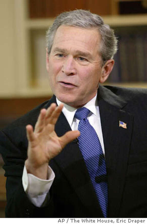"""President Bush makes a point as he is interviewed on NBC's """"Meet the Press"""" during a pre-taping Saturday, Feb. 7, 2004, in the Oval Office of the White House in Washington. During the interview with NBC moderator Tim Russert Bush denied he led the nation to war under false pretenses. The show aired on NBC Sunday, Feb. 8, 2004. (AP Photo/The White House, Eric Draper) Photo: ERIC DRAPER"""