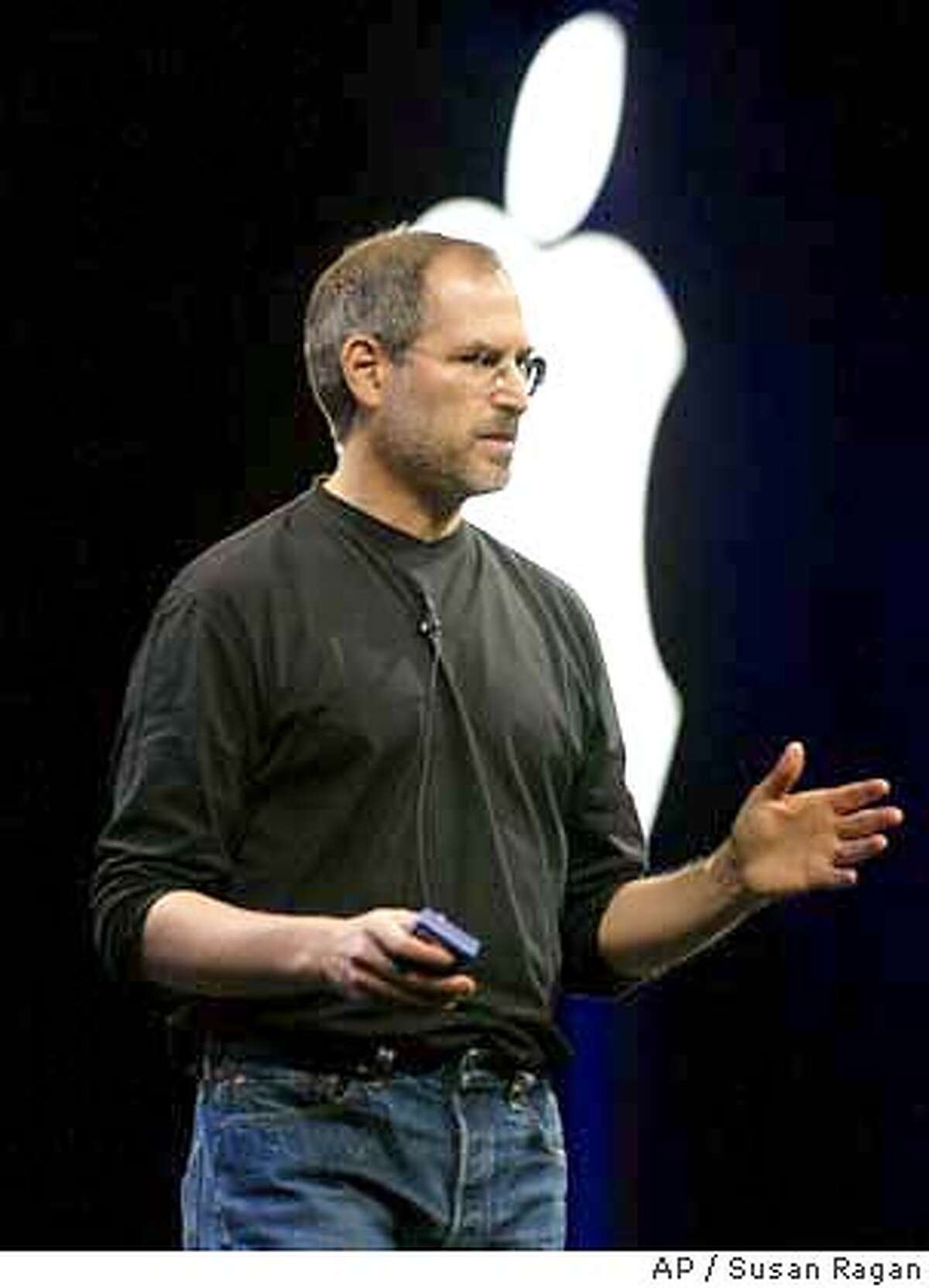Apple CEO Steve Jobs introduces the new Mac OS Panther at the Apple Worldwide Developers Conference in San Francisco on Monday, June 23, 2003. Jobs also introduced the new G5 computer made in collaboration with IBM. (AP Photo/Susan Ragan)