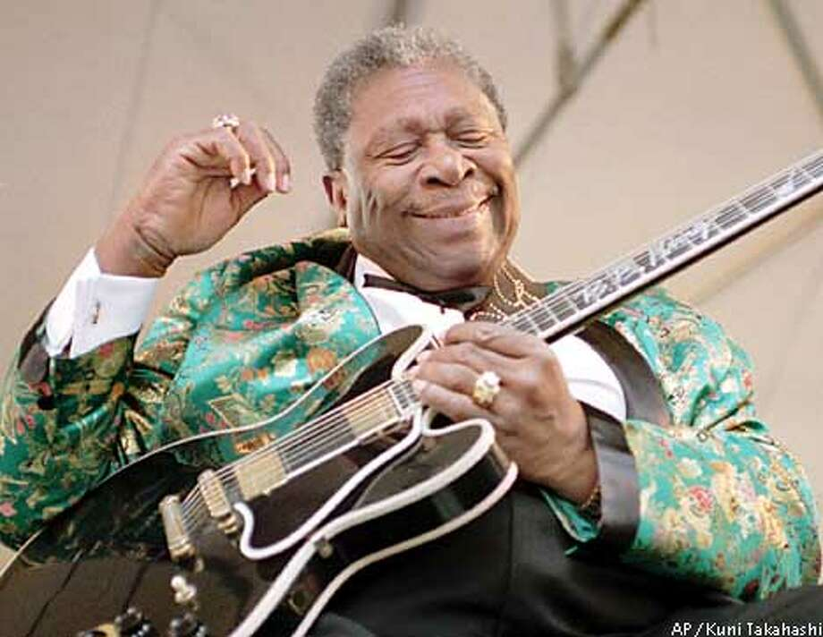 Legendary blues guitarist B.B. King performs for students at Tufts University in Medford, Mass., Saturday, April 29, 1995, after he received the Tufts University Music Department Lifetime Achievement Award. The award was established by Tufts this year to honor the 100th anniversary of the music department, and is intended to honor artists whose contributions and work have had a profound effect on the world of music. (AP Photo/Kuni Takahashi)