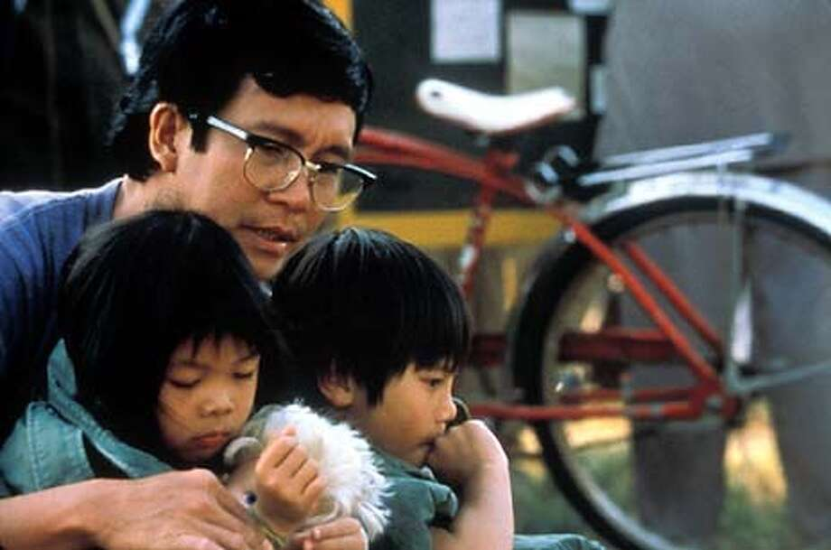 """Green Dragon,"" a film by Timothy Linh Bui. Tai Tran (Don Duong) with children (l-r) Anh (Jennifer Tran) and Minh Pham (Trung Nguyen). Photo: HO"