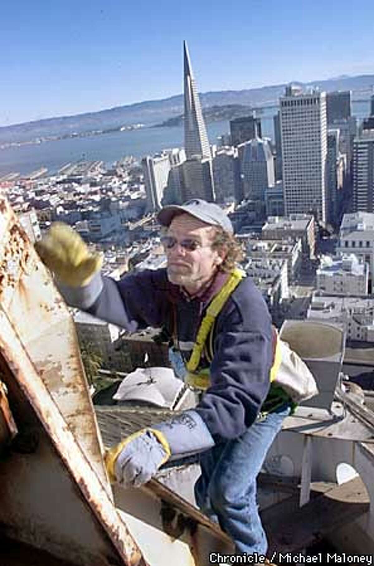 Jim Phelan climbs up the base of a 70 foot fiberglass flagpole on top of the Mark Hopkins Hotel in SF. He was hired to replace the worn out flag rigging. Phelan is a steeplejack who climbs up anything for a living. His business, the J.C. Phelan Company dates back to his grandfather, who worked as a steeplejack in Waterford, Ireland, over 100 years ago. CHRONICLE PHOTO BY MICHAEL MALONEY