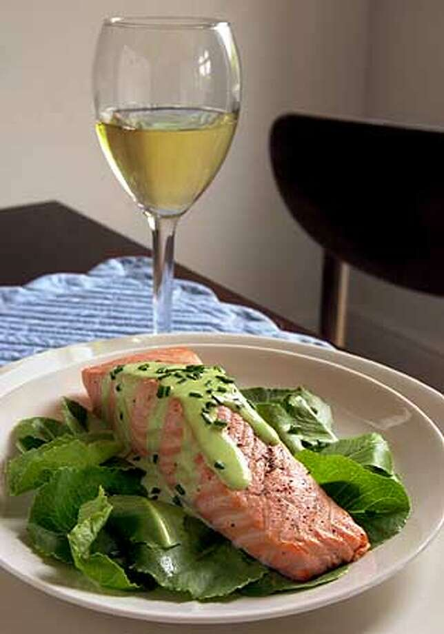 It's A Match: Celadon-hued arugula sauce contrasts beautifully with the rich orange-pink of salmon. Chronicle photo by Lacy Atkins