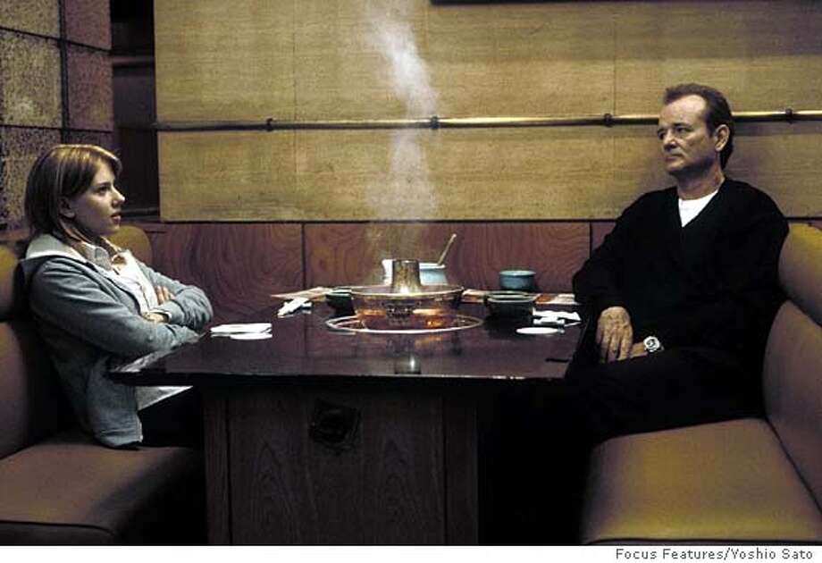 "Actor Bill Murray, right, and Scarlett Johansson star in Sofia Coppola's ""Lost In Translation,"" in this undated promotional photo. The Motion Picture Association of America and top studios want to ban DVD and videotape screeners sent to Academy Awards voters of films competing for Oscar nominations. Studio and MPAA leaders say the move is an attempt to fight piracy, but studio-owned boutique banners such as Focus Features, Miramax and Sony Pictures Classics say the ban would undermine the prospects fortheir films to snag Oscar nominations.  (AP Photo/Yoshio Sato, Focus Features) Scarlett Johansson and Bill Murray chatted during a meal in Oscar-nominated &quo;Lost in Translation.&quo; Photo: YOSHIO SATO"