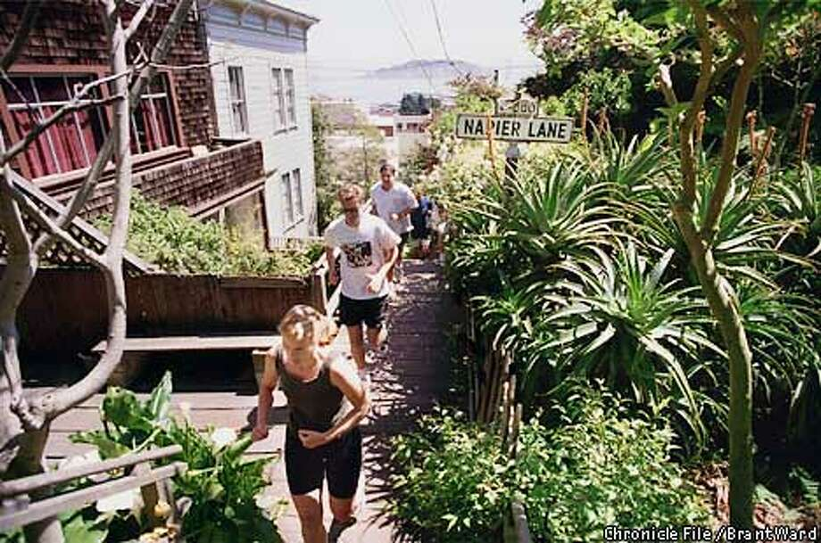 "Runners pass Marchant Garden as they take on the Filbert Steps from Sansome Street on Telegraph Hill. Adah Bakalinsky's ""Stairway Walks of San Francisco"" details the joys of exploring these hidden treasures."