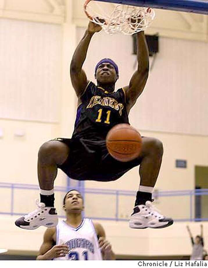 Kennedy-Fremont vs. Newark Cougars at Newark Memorial. Kennedy star Devonte Thomas slam dunks in the second period. Shot on 2/6/04 in Newark. LIZ HAFALIA / The Chronicle Photo: LIZ HAFALIA