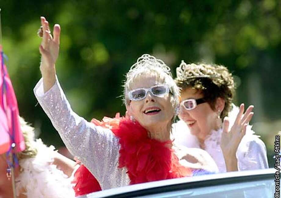 """Irene Allen, 70 years old, blows kisses and waves to the crowd along Bridgeway in Sausalito, for the 4th of July Parade. She was among four others from the """"Sausalito Scintillating Summertime Queens """" float. PHOTO BY LACY ATKINS/CHRONICLE Photo: Lacy Atkins"""