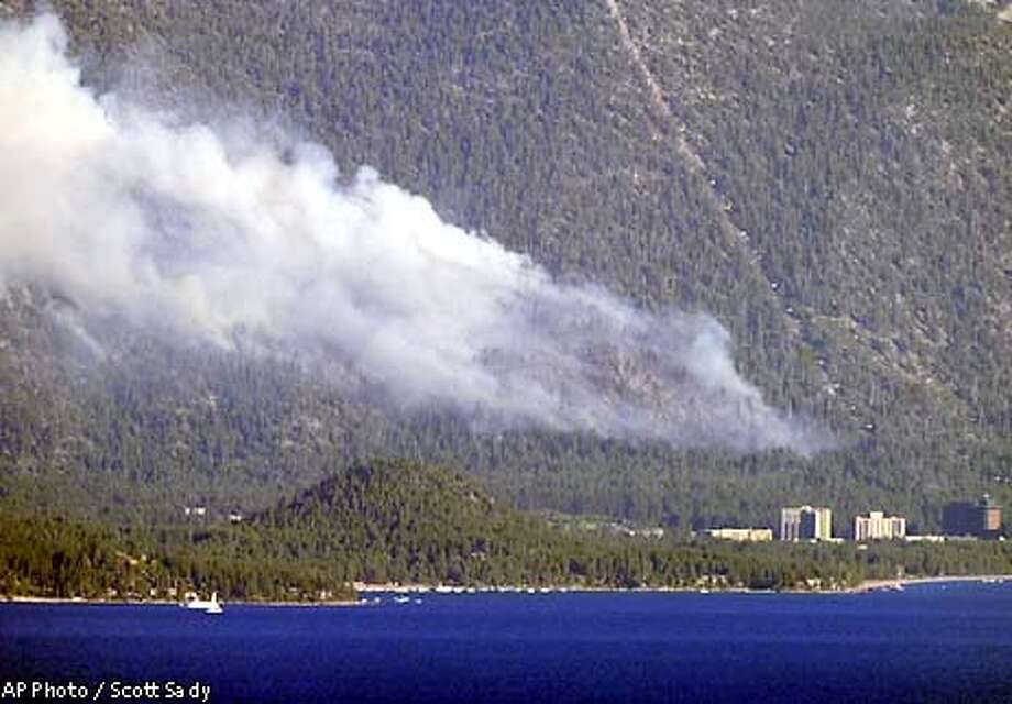 Smoke from the Gondola fire drifts into the air above the hotel and casinos of Stateline, Nev., Wednesday, July 3, 2002 on Lake Tahoe. (AP Photo/Reno Gazette-Journal, Scott Sady) Photo: SCOTT SADY