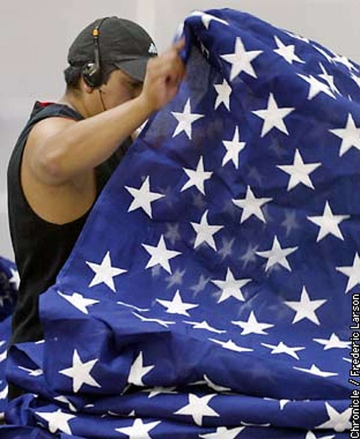 : Jose Olguin works for North Bay Industries in Rohnert Park which is a industries that is a maker of U.S. flags in the Bay Area which they specializes in flags that are used for caskets. Chronicle photo by Frederic Larson