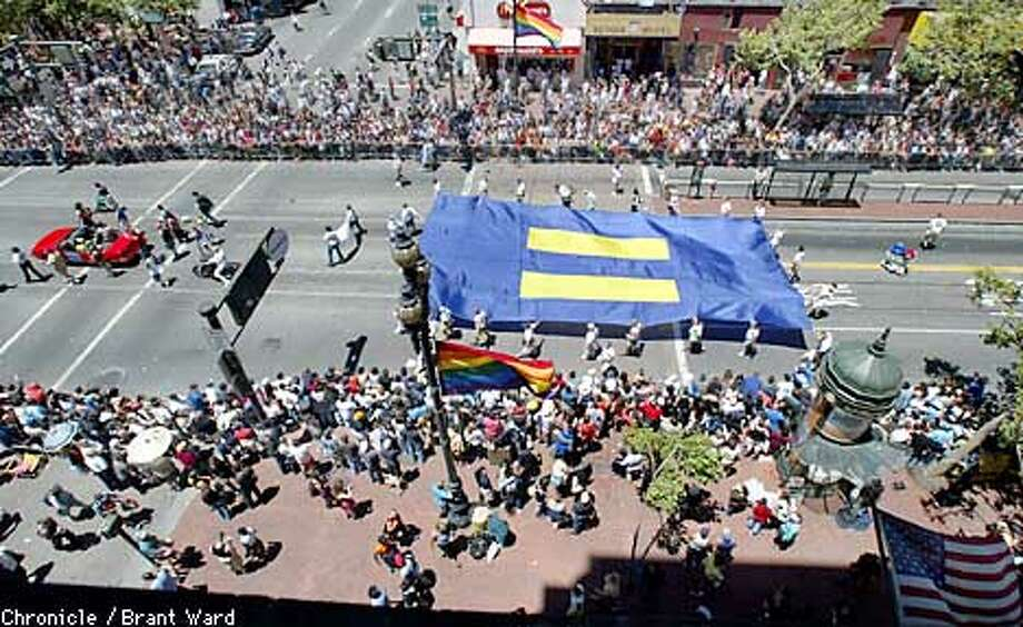 """The Gay Pride parade extended all the way down Market Street for much of the day Sunday...here at Seventh and Market Streets, the Human Rights Campaign complete with their huge """"equal"""" flag passed to the applause of hundreds. By Brant Ward/Chronicle Photo: BRANT WARD"""