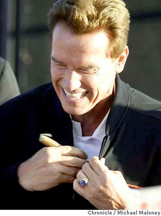 Arnold Schwarzenegger tucks a cigar into his pocket that was given to him by a supporter in the crowd after his speech.  Arnold Schwarzenegger held a rally at the Alameda County Fairgrounds this afternoon.  The Schwarzenegger for Governor Campaign kicked off the California Comeback Express, a four-day statewide bus tour starting in San Diego and ending on the steps of the capitol in Sacramento.  Event on 10/4/03 in Pleasanton.  MICHAEL MALONEY / The Chronicle Photo: MICHAEL MALONEY