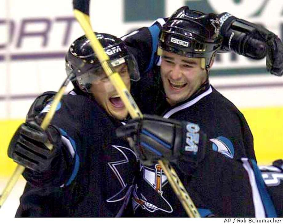 San Jose sharks' Teemu Selanne, left, celebrates with Patrick Marleau after scoring his overtime goal to defeat the Phoenix Coyotes 3-2 during NHL action Tuesday night, Dec. 3, 2002 at America West Arena in Phoenix.(AP Photo/Arizona Republic, Rob Schumacher) CAT MARICOPA COUNTY OUT; MESA TRIBUNE OUT, , NO MAGS Photo: ROB SCHUMACHER