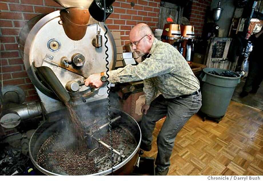 Co-owner Terry Trobough roats coffee in the front of his Connoisseur Coffee Company store. 1/29/04 in Redwood City. DARRYL BUSH / The Chronicle Photo: DARRYL BUSH