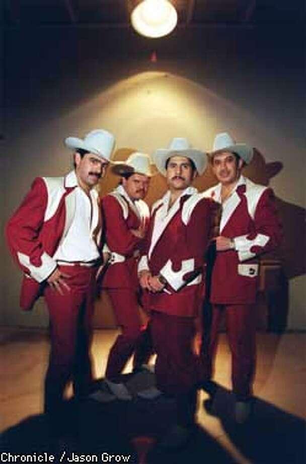 NARCO 10/C/7OCT97/MN/JG-- Los Tucanes de Tijuana. left to right: Joel Helguera, lead singer Mario Quintero, David Servin and Mario Quintero. CHRONICLE PHOTO BY JASON GROW