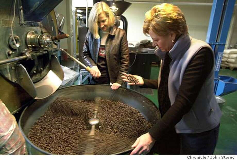 Master roaster Brooke McDonnell roasts coffee at the Equator coffee company. Helen Russell (right) looks over the freshky roated beans with Brooke McDonnell. John Storey/The Chronicle Photo: John Storey