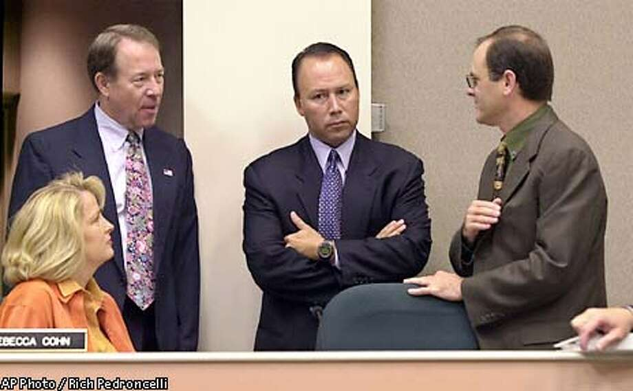 Assemblyman Dean Florez, D-Shafter, center, chairman of the Joint Legislative Audit Committee, listens as committee members, Assemblyman Bill Leonard, R-Rancho Cucamonga, second from left, and state Sen. Steve Peace, D-Chula Vista, right, discuss the failure of an Oracle Corp., lobbyist to testify at the Capitol in Sacramento, Calif., Wednesday, June 12, 2002. Lobbyist Ravi Mehta, who represented Oracle during its negotiations with the state for a $95 million, no-bid software contract, failed to appear before the committee as scheduled. Florez later announced that a subpoena had been issued for Mehta to appear before the committee Thursday. Sitting at right is Assemblywoman Rebecca Cohn, D-Saratoga.(AP Photo/Rich Pedroncelli) Photo: RICH PEDRONCELL