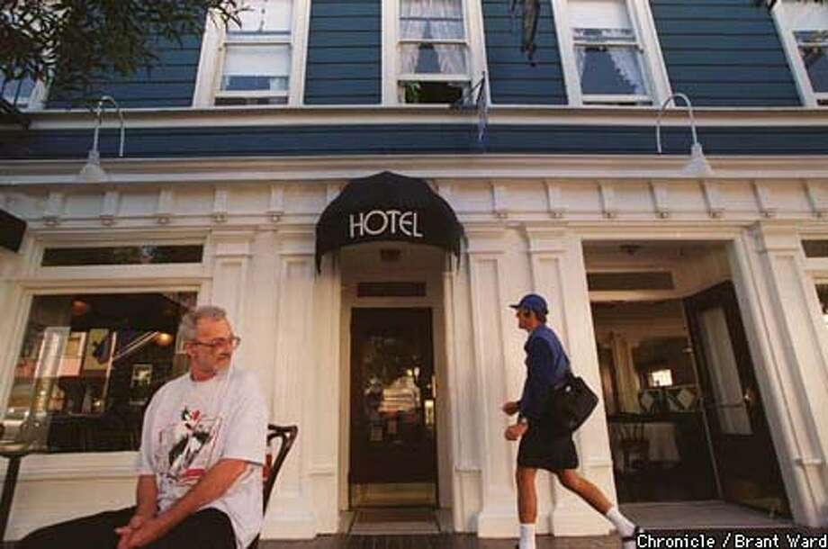 17 year resident Joel Schreiber, left, watched as a tourist arrived back at the San Remo Hotel on Mason Street. The charming hotel has been called the best bargain in SF, but City Hall is making life miserable for the owners. By Brant Ward/Chronicle