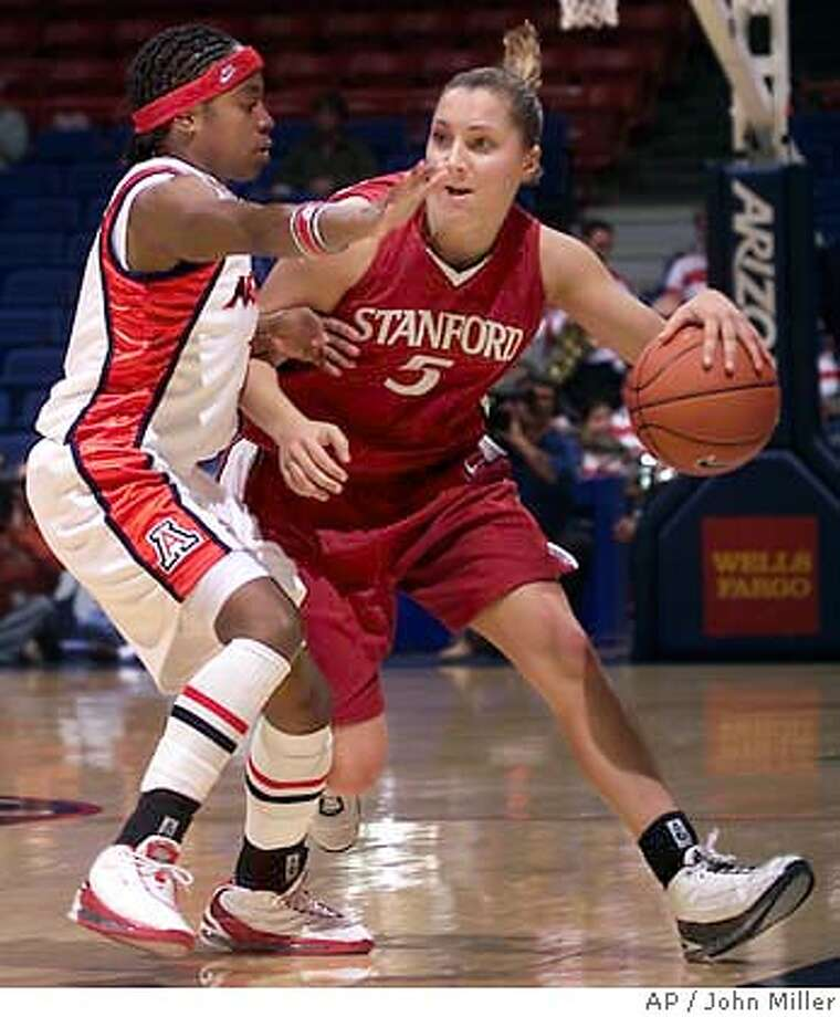 Stanford's Kelley Suminski (5) dribbles around the attempted blocking defense of Arizona's Dee-Dee Wheeler, left, during the first half at McKale Center in Tucson, Ariz., on Thursday, Feb. 5, 2004. (AP Photo/John Miller) Photo: JOHN MILLER