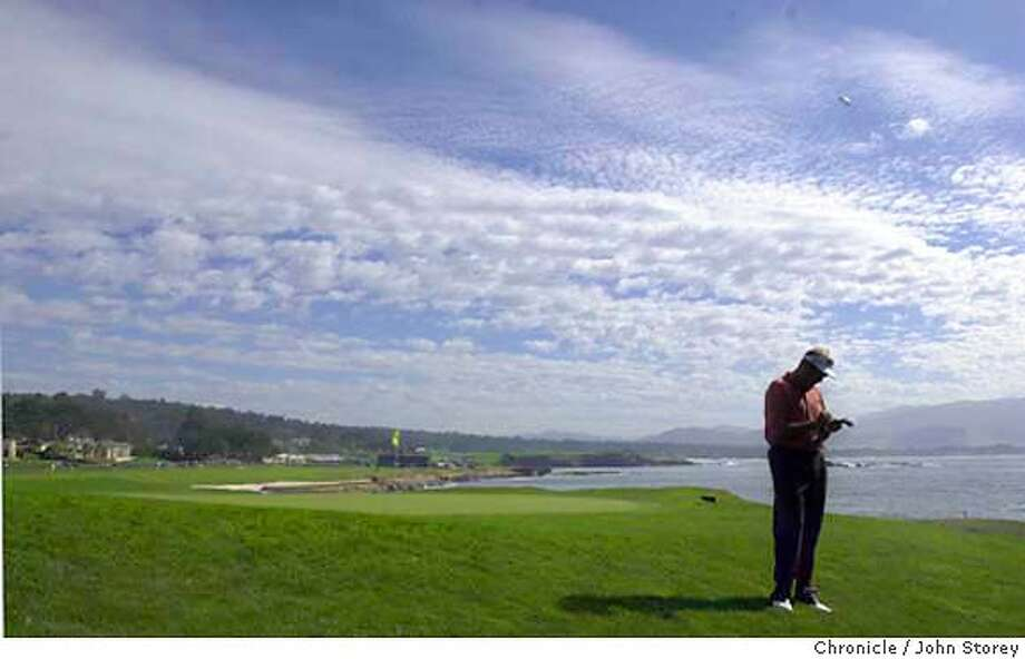 The second round of the AT&T golf tournament in Pebble Beach. Ken Duke marks his score card at the 18th green at Pebble Beach golf course. John Storey/The Chronicle Photo: John Storey