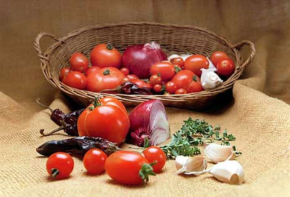 Basics: Simple ingredients such as tomatoes, onions, garlic, chiles and fresh herbs are integral to many sauces and salsas. Chronicle photo by Eric Luse