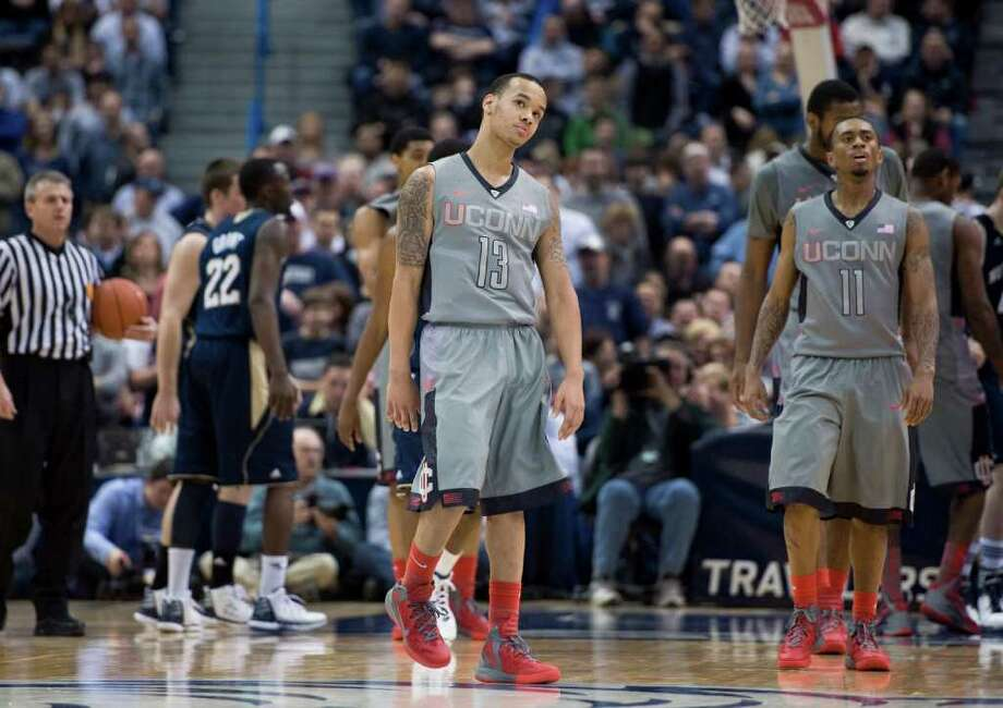 Connecticut's Shabazz Napier (13) and Ryan Boatright (11) react after a foul in the second half of an NCAA college basketball game against Notre Dame in Hartford, Conn., Sunday, Jan. 29, 2012. Notre Dame won 50-48. Photo: AP