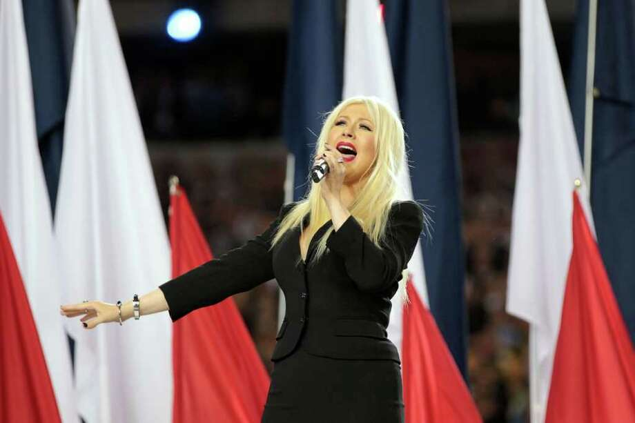 Christina Aguilera (33):Doesn't she know they put the words to the national anthem on the jumbotron? Photo: Jamie Squire, Getty Images / 2011 Getty Images