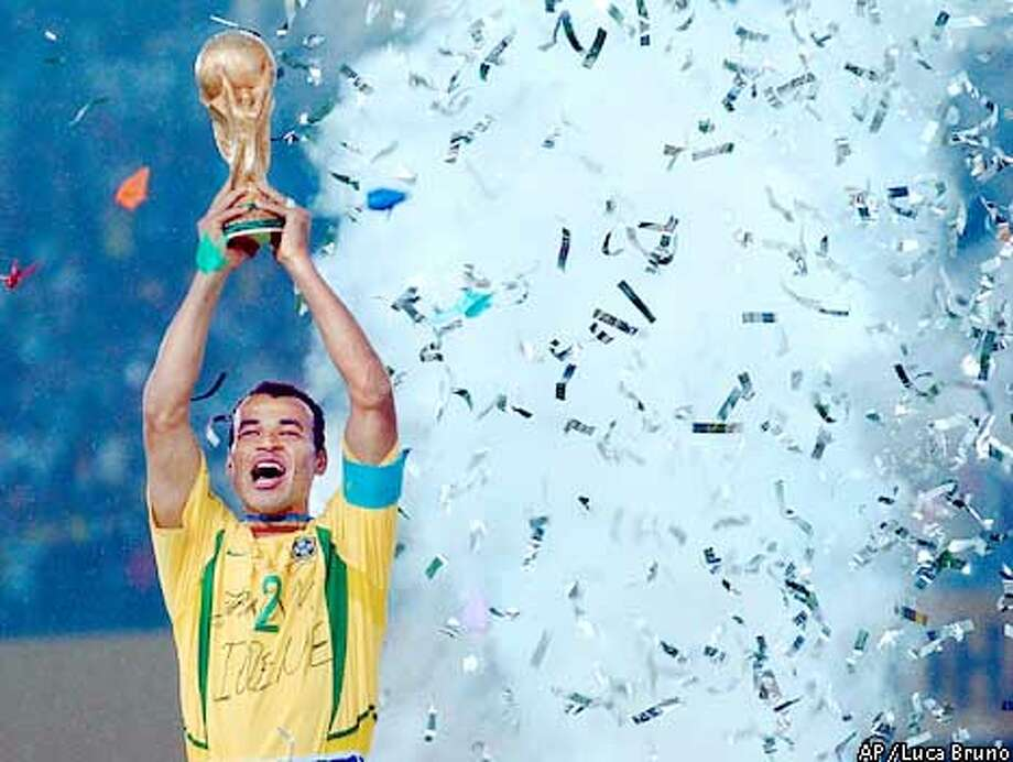 Brazil's captain Cafu holds the trophy after the 2002 World Cup final soccer match between Brazil and Germany Sunday, June 30, 2002 in Yokohama, Japan. Brazil won the match 2-0. (AP Photo/Luca Bruno) Photo: LUCA BRUNO