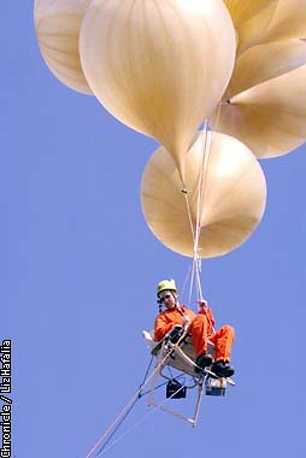 As a stunt marking the 20th anniversary of Larry Graham's lawn-chair balloon flight in L.A., a TV documentary crew tethered Adam Savage to a lawn chair with helium balloons.  (PHOTOGRAPHED BY LIZ HAFALIA/THE SAN FRANCISCO CHRONICLE) Photo: LIZ HAFALIA