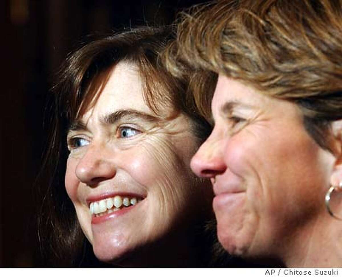Julie Goodridge, left, and her partner Hillary, right, who are the plaintiffs in the Massachusetts lawsuit, speaks to reporters following a news conference in Boston, Wednesday, Feb. 4, 2004 to discuss the advisory opinion issued by the Massachusetts Supreme Judicial Court on Wednesday. The court issued the opinion that only full, equal marriage rights for gay couples, rather than civil unions, would meet the edict of its November 2003 decision, in response to an advisory request from thestate Senate. (AP Photo/Chitose Suzuki)