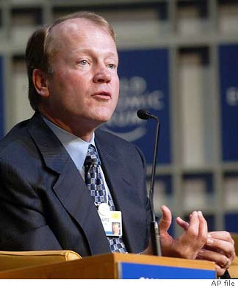 President of Cisco System, American John Chambers, gestures as he speaks during a panel at the World Economic Forum in Davos, Switzerland, Sunday Jan. 25, 2004.(AP Photo/Michel Euler) Photo: MICHEL EULER