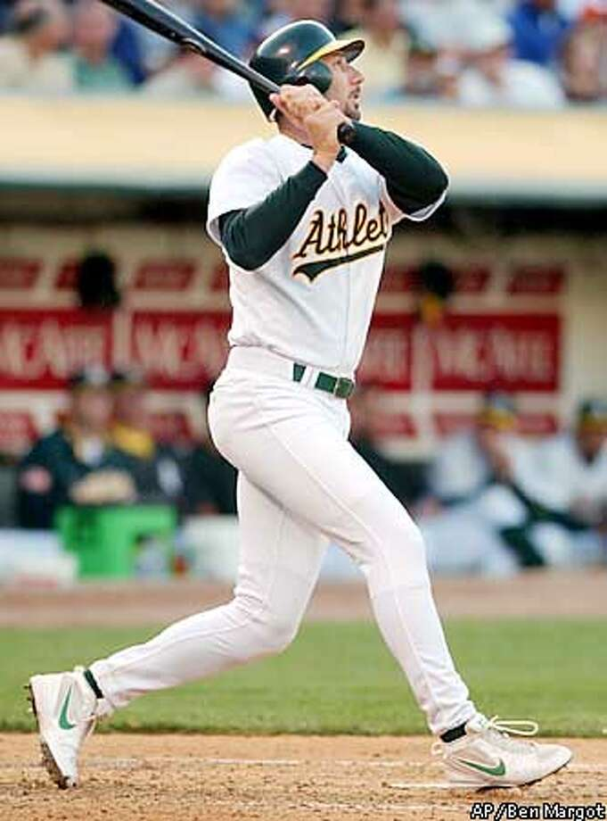 Oakland Athletics' John Mabry swings for a three-run homer off Minnesota Twins' Kyle Lohse in the second inning Monday, July 1, 2002, in Oakland, Calif. (AP Photo/Ben Margot) Photo: BEN MARGOT