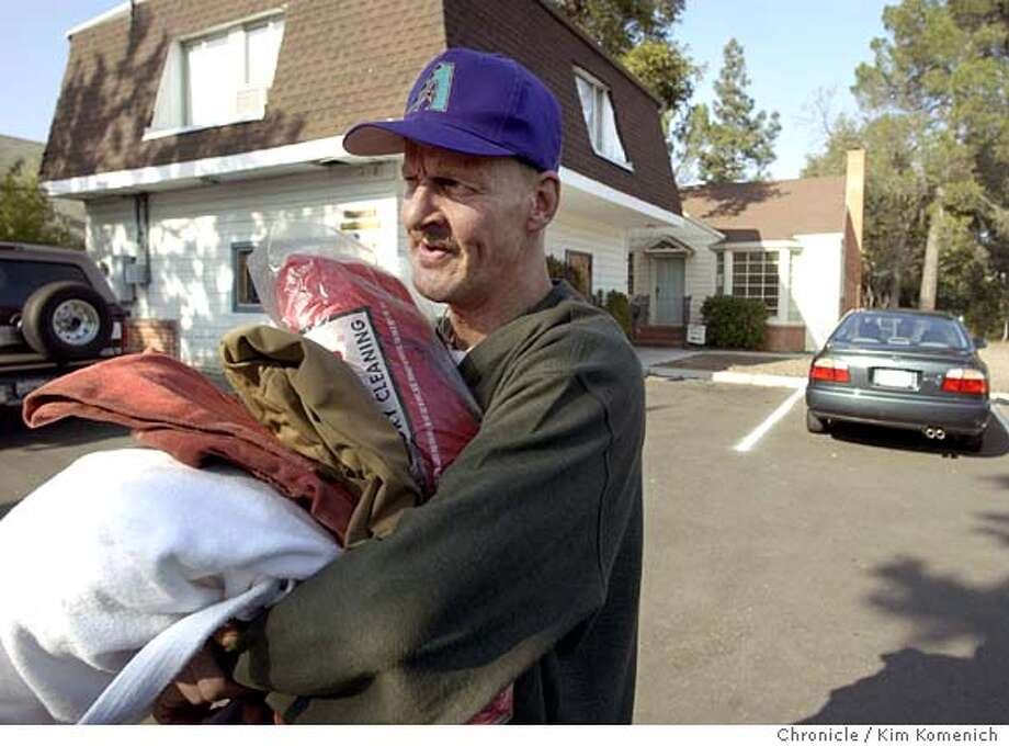 Client Brent Mackie carries away some blankets after havin g lunch at Fresh Start.  Fresh Start for the Homeless is a drop in center for homeless people in Walnut Creek. It's open on Tuesday and Thursday afternoons for people to get a meal, was their clothes and socialize. KIM KOMENICH/The Chronicle Photo: KIM KOMENICH