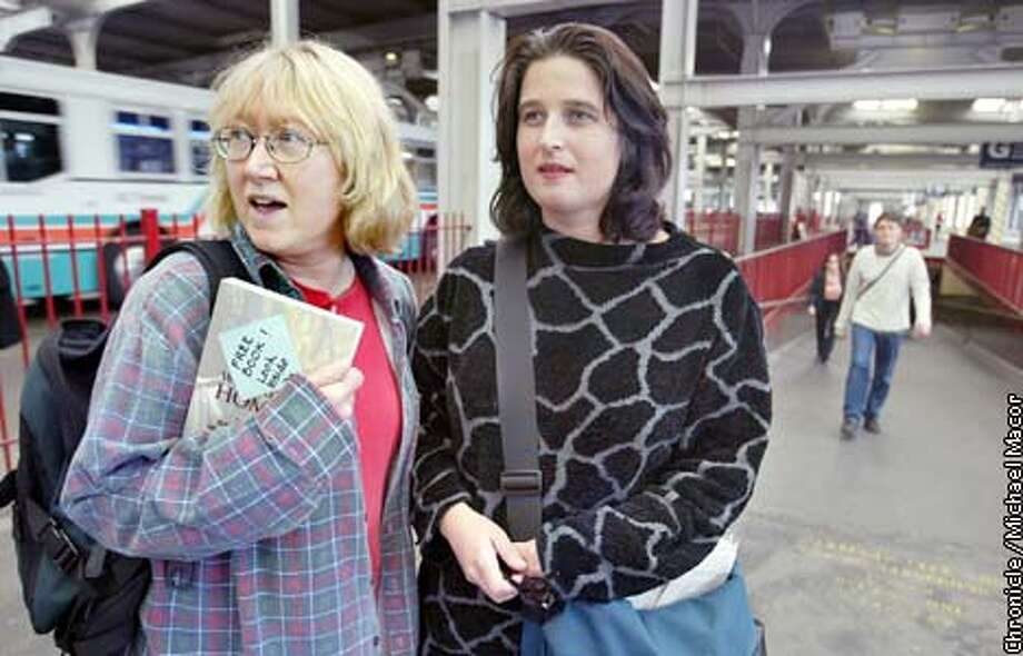 Judy Hardin, left, and Jo Beaton scope out the Transbay Terminal in San Francisco for their next drop for BookCrossing.com. Chronicle photo by Michael Macor