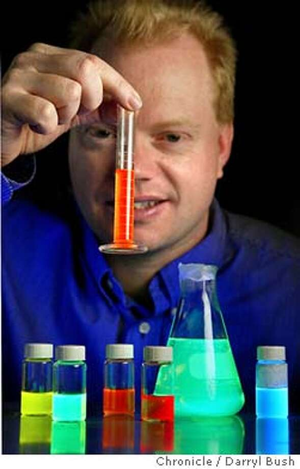 Andy Watson, vice-president of business development for QuantumDot, holds test tubes of QuantumDot nanocrystals that glow when lit by ultraviolet light. The crystals are used for medical diagnostics. 1/28/04 in Hayward. DARRYL BUSH / The Chronicle Photo: DARRYL BUSH