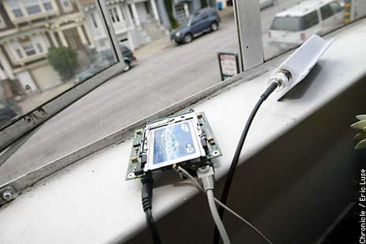 Dan Augustine, co-founder of SF WIreless leaves the antenna and computer componet on his window allowing users in his neighborhood to access the internet for free. BY ERIC LUSE/THE CHRONICLE