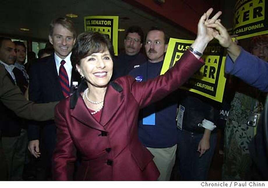 dems18_161.JPG U.S. Senator Barbara Boxer walks into the ballroom to a thunderous ovation as she's introduced at the convention Saturday. The California State Democratic Convention in San Jose on 1/17/04. PAUL CHINN / The Chronicle Photo: PAUL CHINN