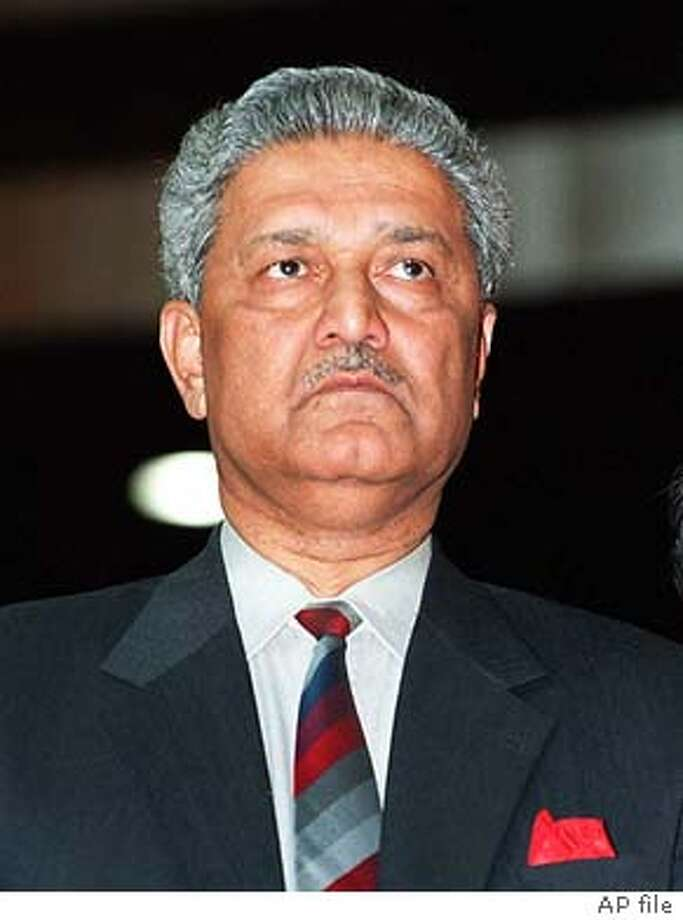 ** FILE ** The founder of Pakistan's nuclear program, Dr. Abdul Qadeer Khan, is seen in this March 19, 1998 photo. Khan has admitted he transferred nuclear technology to Iran, Libya and North Korea, a Pakistani government official said Monday, Feb. 2, 2004. (AP Photo/B. K. Bangash, File) Photo: B. K. BANGASH