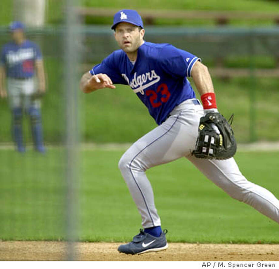 Los Angeles Dodgers first baseman Eric Karros runs for a ball during fielding practice Friday Feb. 22, 2002 in Vero Beach, Fla. (AP Photo/M. Spencer Green) Photo: M. SPENCER GREEN