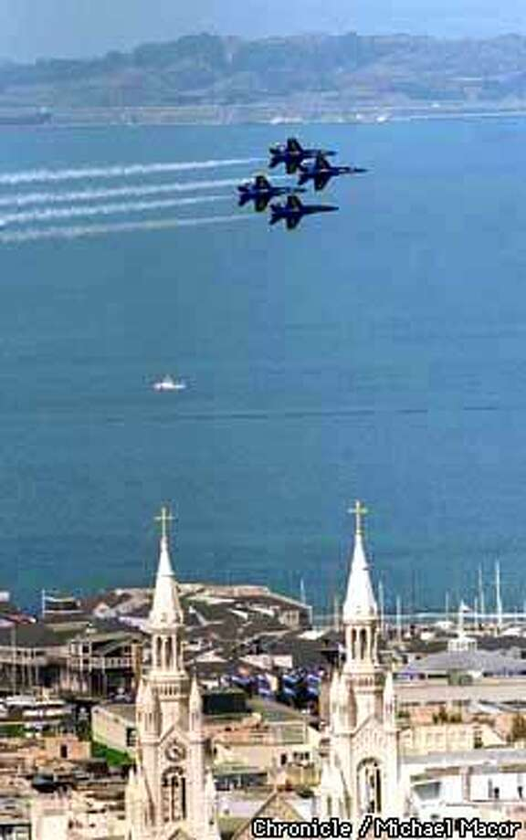 The Navy Blue Angels practice their routine Thursday afternoon in preperations for the Fleet Week Air Show over the weekend. They pass over St. Peter and Paul Cathedral in the Northbeach area. Chronicle Photo : Michael Macor Photo: MICHAEL MACOR