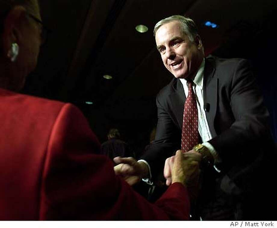 Democratic Presidential candidate Howard Dean greets supporters on the eve of the Arizona Primary Monday, Feb. 2, 2004 at a rally in Phoenix. (AP Photo/Matt York)