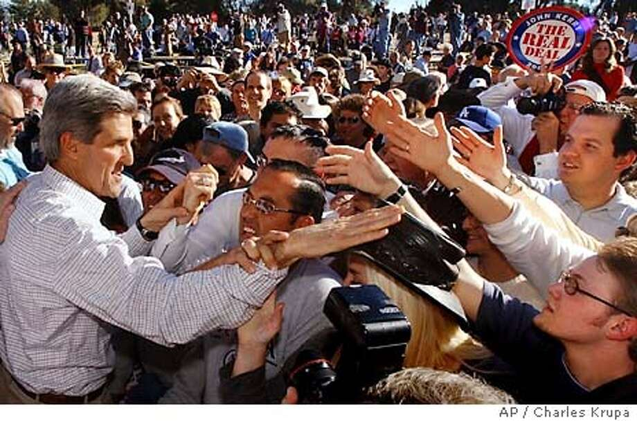 Democratic presidential hopeful U.S. Sen. John Kerry, D-Mass., reaches into a crowd of more than 1,000 people following a rally at Reid Park in Tucson, Ariz., Monday Feb. 2, 2004. (AP Photo/Charles Krupa) Photo: CHARLES KRUPA