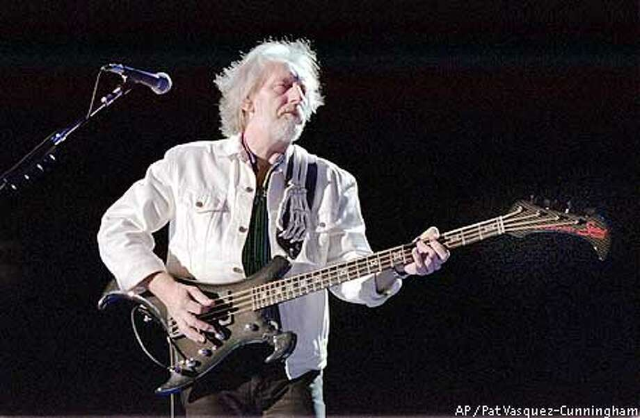 The Who bassist John Entwistle performs with the two original members of the band lead singer Roger Daltrey and guitarist Pete Townshend during an Aug. 25, 2000 concert in Albuquerque, N.M. (AP Photo/Pat Vasquez-Cunningham)