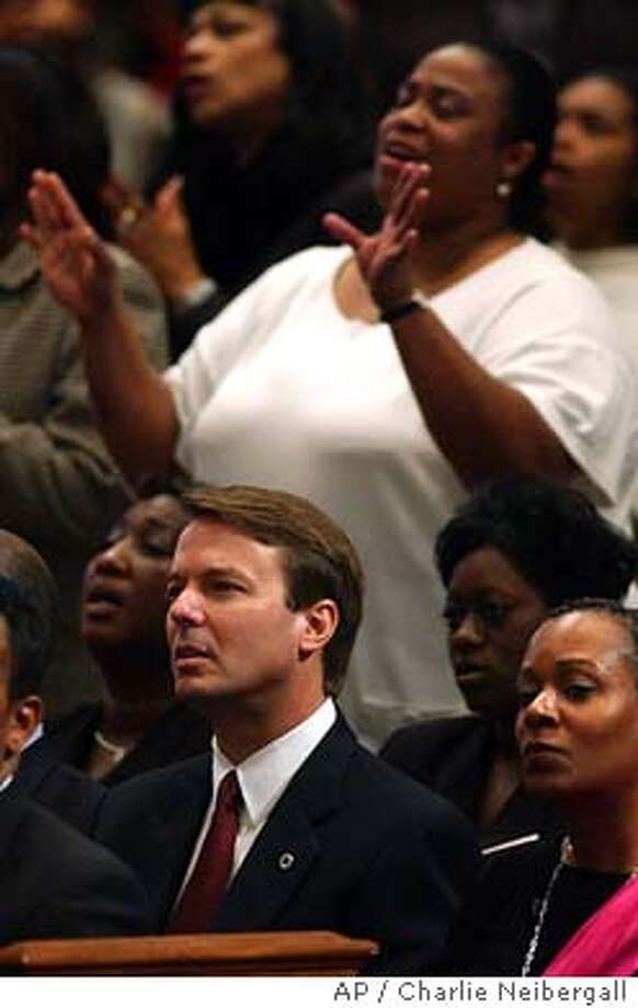 Democratic presidential hopeful Sen. John Edwards, D-N.C., attends morning services, Sunday Feb. 1, 2004, at the Bible Way Church of Atlas Road in Columbia, S.C. (AP Photo/Charlie Neibergall) Photo: CHARLIE NEIBERGALL