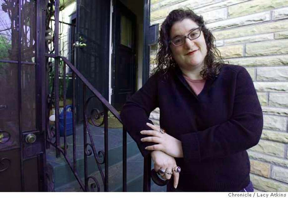 """DISAPPEAR_017_.jpg LIsa Jervis, at 720 square foot home in Oakland that she purchased for $335,000,. """"I really do feel like the exception,not the rule"""", Jervis said. Lacy Atkins / The Chronicle MANDATORY CREDIT FOR PHOTOG AND SF CHRONICLE/ -MAGS OUT Photo: Lacy Atkins"""